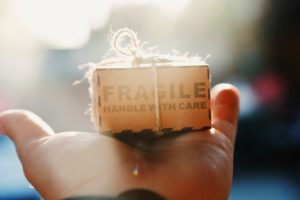 person holding Fragile box